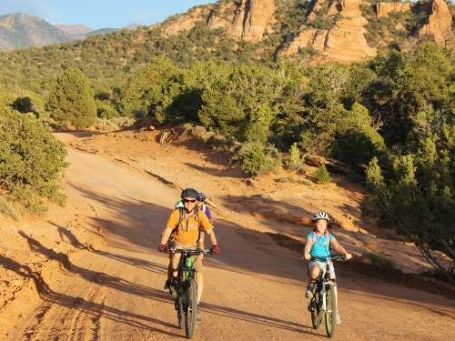 Family biking on the Sunrise Downhill guided mountain bike tour from the La Sal Mountain above Moab, UT