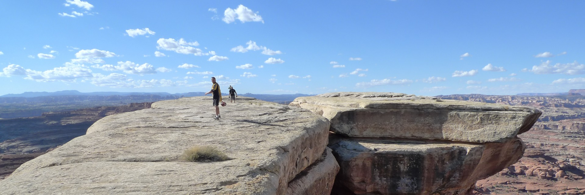 The White Rim Trail guided mountain bike tour includes lots of side hikes such as these folks are enjoying