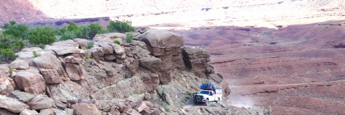 A Rim Tours four-wheel-drive support truck drives up the final section of the climb over Murphy's Hogback on the White Rim Trail guided tour