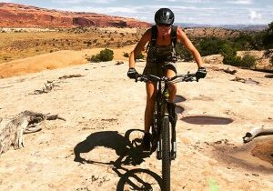 Office Manager Maria Olschewski riding near Moab UT