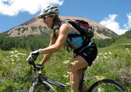 Day Tour Manager Melissa Nerone rides Burro Pass in the La Sal Mountains near Moab UT